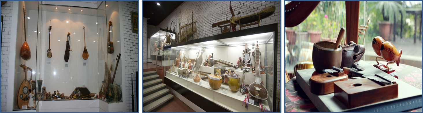 all the pictures are various wooden musical instruments like guitars, drums, etc exhibited at the indoor exhibition hall.